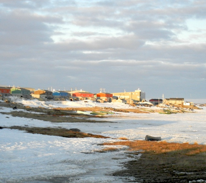 Late evening sunlight illuminates the Nunavik community of Puvirnituq on northern Quebec's Hudson Bay coast. (PHOTO BY JANE GEORGE)