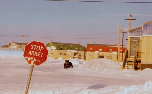 A trilingual stop sign in InukJuak, spring of 1996. (PHOTO BY JANE GEORGE)