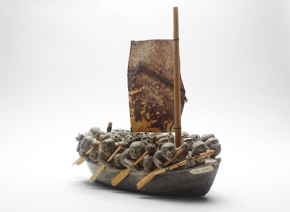 The Migration by Puvirnituq carver and printmaker Joe Talirunili. Talirunili's carving depicts an event when the boat on which he was travelling was nearly trapped by crushing ice in Hudson Bay. (PHOTO/ART GALLERY OF ONTARIO)