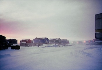 A view down a street in Puvirnituq with the Inuulitsivik Health Centre to the right. (PHOTO BY JANE GEORGE)