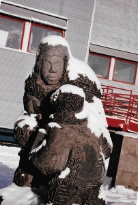 This large carving of a mother and her child made by Peter Ittukallak stands outside the Iguarsivik School in Puvirnituq. (PHOTO BY JANE GEORGE)