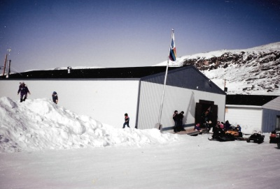 A big pile of snow beside the co-op store in Salluit is a draw to kids in the spring of 1996. (PHOTO BY JANE GEORGE)
