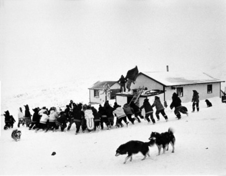 Christmas candy drop in Quaqtaq, 1963. (PHOTO. AVATAQ ARCHIVES, IND-DIO-930)