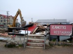 The Kamotiq Inn at Iqaluit's Four Corners intersection is torn down in 2008. (PHOTO BY JANE GEORGE)
