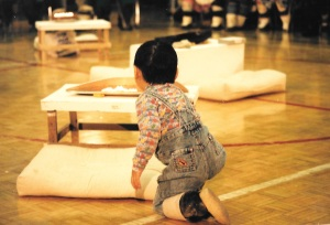 A boy looks at the qulliit lit at 1997's Return of the Sun ceremony in Igloolik. (PHOTO BY JANE GEORGE)