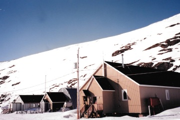 Many buildings in the avalanche zone in Kangiqsualujjuaq, SEEN HERE IN MAY, 1999, would be removed. (PHOTO BY JANE GEORGE)