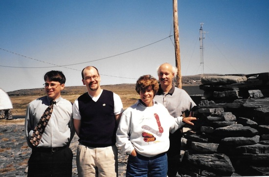 TNI's George Berthe, Avataq's Robbie Watt, Min. Louise Beaudoin and Ungava MNA Luc Ferland stand next to an inuksuk in Inukjuak June 16, 1998. (PHOTO BY JANE GEORGE)