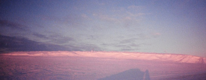 Pink light illuminates the cemetery in Igloolik in January, 1997. (PHOTO BY JANE GEORGE)