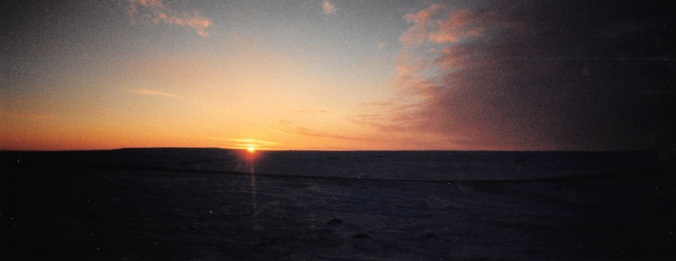 The sun rises over the horizon in mid-January, 1997. (PHOTO BY JANE GEORGE)