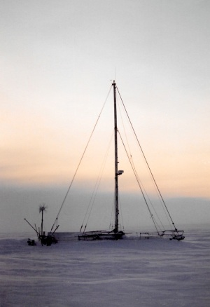 A sailboat, frozen in the sea ice outside Igloolik, is home to two sailors from France during the winter of 1997. (PHOTO BY JANE GEORGE)