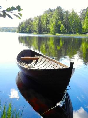 A boat, a lake, sunny skies in Finland. (PHOTO BY JANE GEORGE)