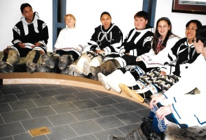 Pages in the Nunavut legislature sit outside in the foyer. (PHOTO BY JANE GEORGE)