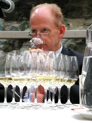 John Ralston Saul quaffs win at a Helsinki wine tasting of Canadian wines during the 2003 state visit to Russia, Finland and Iceland. (PHOTO BY JANE GEORGE)
