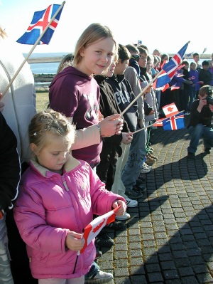 Kids waving Icelandic and Canadian flags welcome the 2003 state visitors in October, 2003. (PHOTO BY JANE GEORGE)