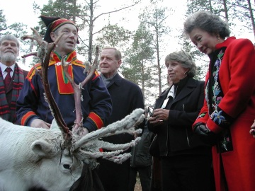 Governor General Adrienne Clarkson (at right) learns about reindeer near Inari in October, 2003. (PHOTO BY JANE GEORGE)