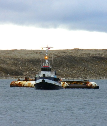 The Tandberg Polar tug arrives in Cambridge Bay with the pontoon barge which will help raise the Maud to the surface. (PHOTO BY JANE GEORGE)