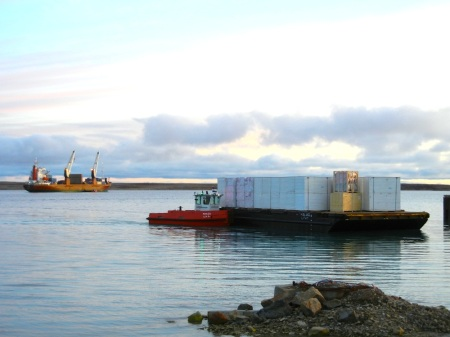 A tug brings containers to shore in Cambridge Bay. (PHOTO BY JANE GEORGE)