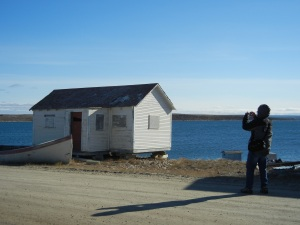 A cruiser takes a photo of an old Hudson Bay Co. building. (PHOTO BY JANE GEORGE)