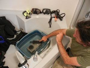 A young researcher washes equipment in jacuzzi. (PHOTO BY JANE GEORGE)