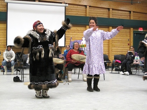 Ariel Tweto, at the right, dances with Trisha Ogina Sept. 27 in Cambridge Bay. (PHOTO BY JANE GEORGE)