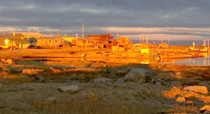Bright light from the setting sun illuminates part of the town Sept. 21. (PHOTO BY JANE GEORGE)