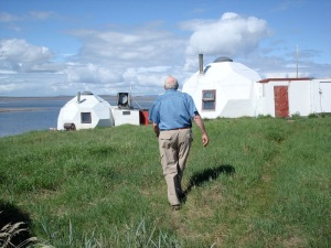 Glenn Warner, who died in 2014 at the age of 80. walks towards two of the three remaining domes at Bathurst Inlet in 2009.