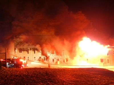 Fire ravages the block of Creekside Village housing in Iqaluit, Feb. 27,  2012. (PHOTO BY JANE GEORGE)