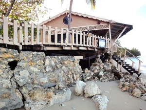 Waves pounded this seaside restaurant in 2011, nearly dragging it down to the beach. (PHOTO BY JANE GEORGE)